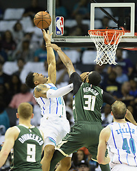 October 17, 2018 - Charlotte, NC, USA - The Charlotte Hornets' Miles Bridges (0) shoots over the Milwaukee Bucks' John Henson (31) during the first half at the Spectrum Center in Charlotte, N.C., on Wednesday, Oct. 17, 2018. (Credit Image: © David T. Foster Iii/Charlotte Observer/TNS via ZUMA Wire)