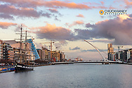 Jeanie Johnston Tall Ship and Samuel Beckett bridge over the River Liffey in downtown Dublin, Ireland
