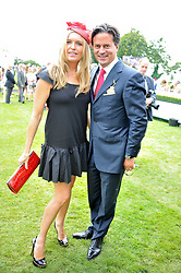 TINA HOBLEY and OLIVER WHEELER at the 3rd day of the 2011 Glorious Goodwood Racing Festival - Ladies Day at Goodwood Racecourse, West Sussex on 28th July 2011.