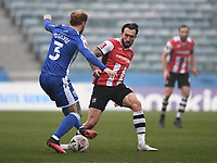 Football - 2020 / 2021 Emirates FA Cup - Round 2 - Gillingham vs Exeter City - Priestfield Stadium<br /> <br /> Gillingham's Connor Ogilvie battles with Exeter City's Rory McArdle.<br /> <br /> COLORSPORT/ASHLEY WESTERN