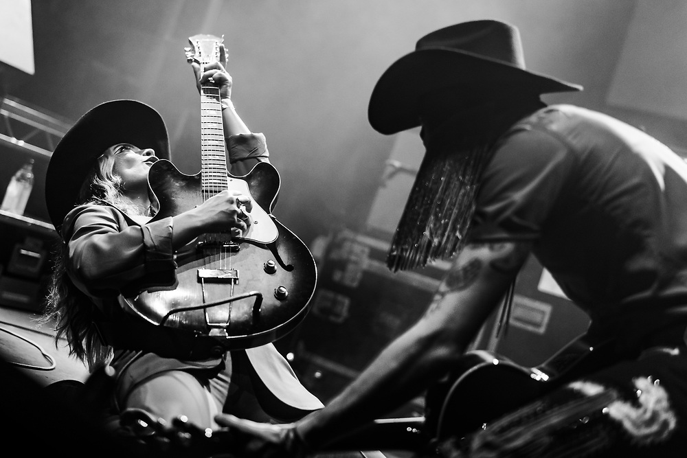Bria Salmena playing guitar for Orville Peck at Iceland Airwaves