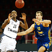 Besiktas's Patrick Christopher (L) and BC Khimki MR's Sergey Monya during their Turkish Airlines Euroleague Basketball Top 16 Game 1 match Besiktas between BC Khimki MR at Abdi ipekci Arena in Istanbul, Turkey, Thursday, December 27, 2012. Photo by TURKPIX