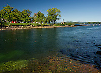 The Weirs Channel looking across to Endicott Rock on the last day of summer.  (Karen Bobotas/for the Laconia Daily Sun)