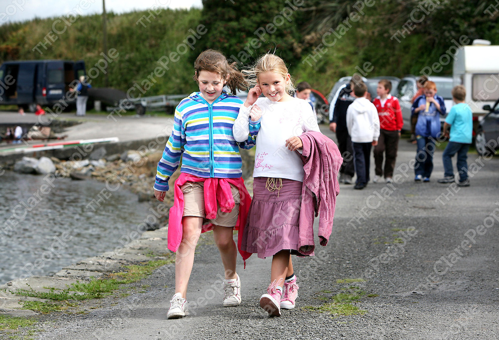 Lauren Keane and Hannah McLoughlin ,Carrigaholt enjoying the Currach Racing at the Kilbaha Festival on Sunday.<br /><br />Photograph  by Eamon Ward