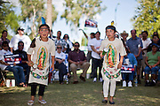 """June 13 - PHOENIX, AZ: CAMILA FRANCO, 7, (left) and her sister, KARITIA FRANCO, 8, from Glendale, AZ, perform a dance honoring the Virgin of Guadalupe during an immigrants' rights rally and vigil at the Arizona State Capitol in Phoenix Sunday. About 40 immigrants' rights activists from Anaheim, California, joined Phoenix area activists at the Arizona State Capitol Sunday for a prayer vigil and rally against SB 1070, the Arizona law that gives local law enforcement agencies the power to ask to see proof of immigration status in the course of a """"lawful contact"""" and when """"practicable."""" Immigrants' rights and civil rights activist say the bill will lead to racial profile. Proponents of the bill say it is the toughest local anti-immigration bill in the country and merely brings state law into line with federal immigration law.  The law, which was signed by the Arizona Governor in April, goes into effect on July 29, 2010.   Photo by Jack Kurtz"""