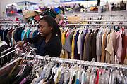 Foster child Aleta organizes clothes at Goodwill in Milpitas, California, on September 26, 2013. (Stan Olszewski/SOSKIphoto)