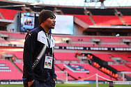 AFC Wimbledon defender Darius Charles (32) walking onto the pitch during the The FA Cup 3rd round match between Tottenham Hotspur and AFC Wimbledon at Wembley Stadium, London, England on 7 January 2018. Photo by Matthew Redman.