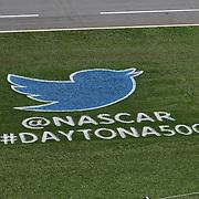 A logo for Twitter and NASCAR is seen painted on the grass during the 58th Annual NASCAR Daytona 500 auto race at Daytona International Speedway on Sunday, February 21, 2016 in Daytona Beach, Florida.  (Alex Menendez via AP)