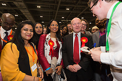 © Licensed to London News Pictures. 12/06/2015. London, UK. Labour's JOHN BIGGS with RUSHANARA ALI speaks to the press at the Excel Centre in London after winning the Tower Hamlets Mayor election. Lutfur Rahman was removed from office for fraud and corrupt practices by an election court earlier this year and the 2014 election was rerun as a result. Photo credit : Vickie Flores/LNP