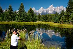 Photographer at Shwabackers Landing in Grand Teton National Park