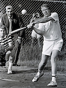 President Jimmy Carter at bat during a softball game at Plains High School in his hometown of Plains, Georgia. The umpire in the background is consumer advocate Ralph Nader and the catcher is James Wooten of ABC News. - To license this image, click on the shopping cart below -