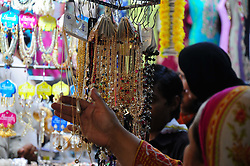 June 11, 2017 - Rawalpindi, Punjab, Pakistan - Ladies choosing artificial jewelries in connection to the preparations of the coming Eidul Azha at Rawalpindi Moti Bazar Market in Pakistan (Credit Image: © Zubair Abbasi/Pacific Press via ZUMA Wire)