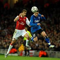 Photo: Ed Godden.<br /> Arsenal v Hamburg. UEFA Champions League, Group G. 21/11/2006. Arsenal's Mathieu Flamini (L) challenges Piotr Trochowski.