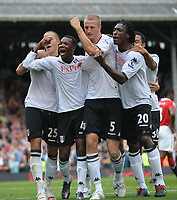 Fotball<br /> England<br /> Foto: Fotosports/Digitalsport<br /> NORWAY ONLY<br /> <br /> Craven Cottage, Fulham v Manchester United, Premier League 22/08/2010<br /> <br /> Brede Hangeland of Fulham celebrates with teamates after making the score 2-2