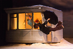 "© Licensed to London News Pictures. 27/01/2015. London, England. Marie Gyselbrecht and Seoljin Kim performing. Belgian dance collective Peeping Tom presents their piece ""32 rue Vandenbranden"" at the Barbican Theatre in association with London International Mime Festival (LIMF) from 28 to 31 January 2015. Show was conceived and directed by Gabriela Carrizo and Franck Chartier with Seoljin Kim, Hun-Mok Jung, Marie Gyselbrecht, Jos Baker, Maria Carolina Vieira and Euridike De Beul performing. Photo credit: Bettina Strenske/LNP"