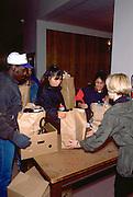 Holiday food shelf participants ages 23 and 41.  Minneapolis Minnesota USA