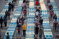 Shoppers are separated by rows of wood pallets to help with physical distancing as they line up to enter a Costco store in Burnaby, BC, Canada on Sunday, April 19, 2020. TPhoto by Darryl Dyck/CP/ABACAPRESS.COM