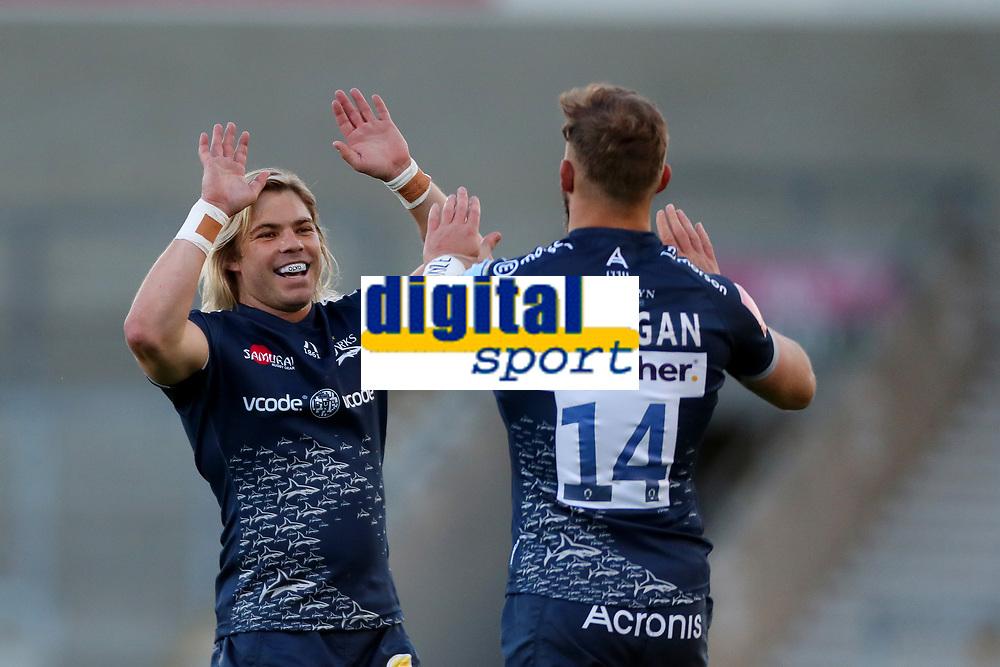 Rugby Union - 2020 / 2021 Gallagher Premiership - Round 18 - Sale Sharks vs Leicester Tigers - A J Bell Stadium<br /> <br /> Faf de Klerk of Sale Sharks celebrates with try scorer Byron McGuigan