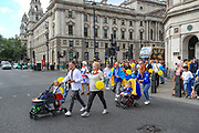 Members of the Ukrainian community in Britain walked towards Westminster Bridge to create a human chain outside Westminster Palace, Houses of Parliament to mark the anniversary of Ukraine's national Flag in central London on Sunday, Aug 22, 2021. (VX Photo/ Vudi Xhymshiti)
