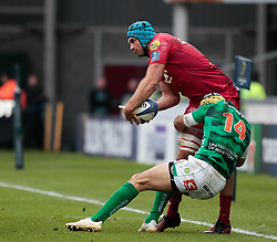 Scarlets' Tadhg Beirne tries to keep the ball in play whilst being tackled by Benetton Rugby's Angelo Esposito<br /> <br /> Photographer Simon King/Replay Images<br /> <br /> EPCR Champions Cup Round 3 - Scarlets v Benetton Rugby - Saturday 9th December 2017 - Parc y Scarlets - Llanelli<br /> <br /> World Copyright © 2017 Replay Images. All rights reserved. info@replayimages.co.uk - www.replayimages.co.uk