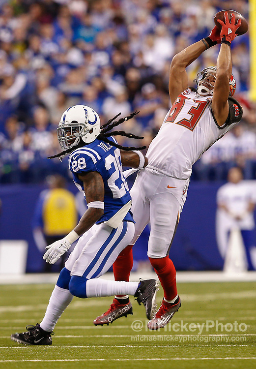INDIANAPOLIS, IN - NOVEMBER 29 : Vincent Jackson #83 of the Tampa Bay Buccaneers reaches for a catch as Greg Toler #28 of the Indianapolis Colts defends at Lucas Oil Stadium on November 29, 2015 in Indianapolis, Indiana. Indianapolis defeated Tampa Bay 25-12. (Photo by Michael Hickey/Getty Images) *** Local Caption *** Vincent Jackson; Greg Toler