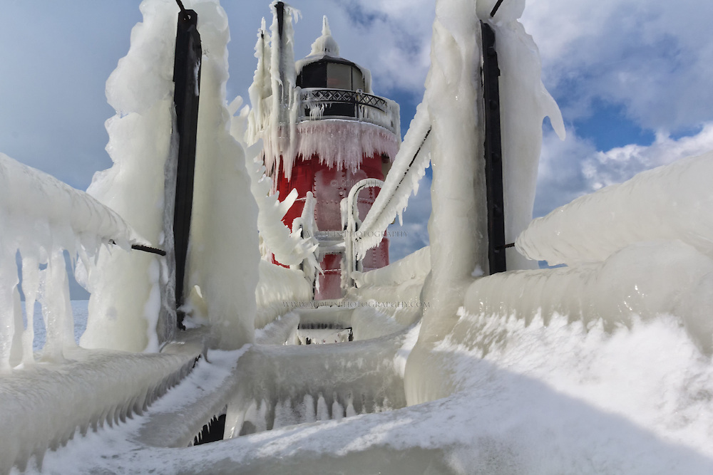 The heavy buildup of ice on the South Haven pier allowed me to climb next to the catwalk to take this image of the lighthouse from an unique vantage point.
