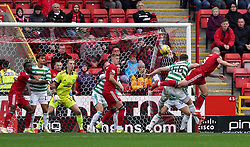 Aberdeen's Scott Brown (right) heads at goal during the cinch Premiership match at Pittodrie Stadium, Aberdeen. Picture date: Sunday October 3, 2021.