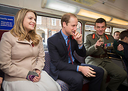 © Licensed to London News Pictures. 07/11/2013.  The Duke of Cambridge shares a joke with General Tim Chicken on board the Royal British Legions Poppy bus today as the charity aimed to collect a million pounds in one day.  The Royal couple met with former and serving soldiers at Kensington Palace and also on High Street Kensington.      Photo credit: Alison Baskerville/LNP