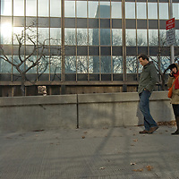 A couple walks through a small plaza north of the U.N. Building in New York City.