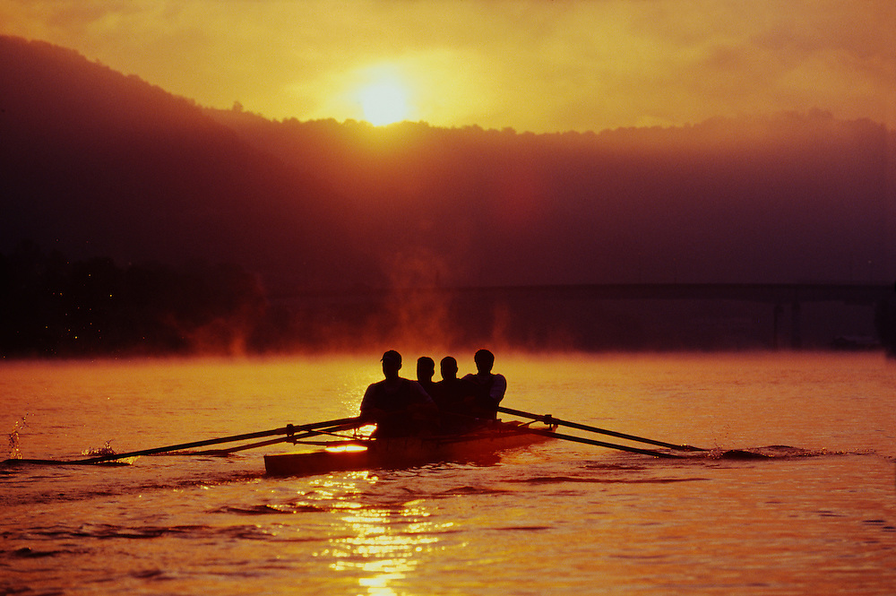 """The sun casts a golden glow through the mist over early morning rowers on West Virginia's Kanawha River. - To license this image, click on the shopping cart below - -- Determine pricing and license this image, simply by clicking """"Add To Cart"""" below --"""