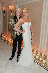 JOHN CAUDWELL and CLAIRE CAUDWELL at a birthday dinner for Claire Caudwell for family & friends held at The Dorchester, Park Lane, London on 24th January 2014.