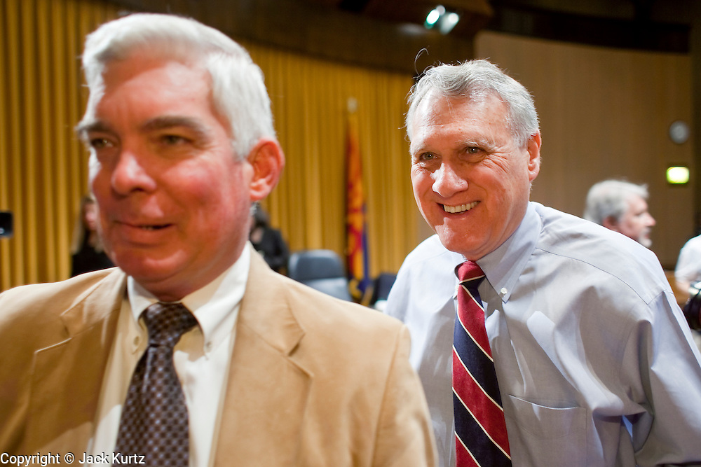 Apr. 20, 2009 -- PHOENIX, AZ: LARRY DEVER, the sheriff of Cochise County, a rural county in southern Arizona on the US/Mexico border, left, leads US Sen JON KYL into a senate committee hearing in Phoenix Monday. The US Senate Committee on Homeland Security and Government Affairs, chaired by Sen. Joe Lieberman (Ind-CT), held a hearing about local perspectives on border violence in the Phoenix City Council chambers in Phoenix, AZ, Monday.   Photo by Jack Kurtz