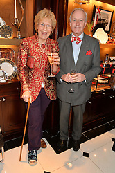NEIL & CHRISTINE HAMILTON at a party to celebrate the publication of 'A Designer's Life' by Nicky Haslam held at Ralph Lauren, 1 New Bond Street, London on 19th November 2014.