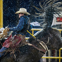 070415       Cable Hoover<br /> <br /> Saddle bronc rider Cody Anthony struggles against his horse and the weather during the PRCA Rodeo in Window Rock Saturday.