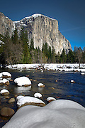 The water flowing down the Merced River in Yosemite National Park with El Capitan in the distance.