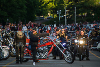 As the sun goes down bikes head into the Weirs for Friday evening.  (Karen Bobotas/for the Laconia Daily Sun)