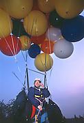 John Ninomiya, a cluster balloonist makes a last minute preflight check before flying over  over Coalinga, California.