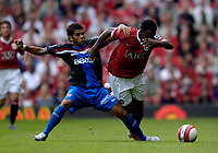 Photo: Jed Wee.<br />Manchester United v Seville. Pre Season Friendly. 12/08/2006.<br /><br />Manchester United's Louis Saha (R) is tackled by Seville's Daniel Alves in one of his numerous physical challenges in the first half.