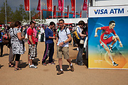 London, UK. Thursday 9th August 2012. London 2012 Olympic Games Park in Stratford. People queue for the ATM cash machine. In the Olympic park you can only use a VISA credit or debit card, or cash. No other cards are accepted.