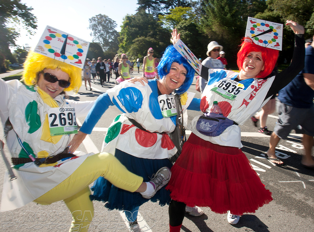 """The """"Twister Sisters,"""" a.k.a. Connie Ives, from left, Kim Fielding and Lisa Gounod, all of Los Altos, Calif., strike a pose from their popular board game for a photograph during the 101st Bay to Breakers 12K footrace, Sunday, May 20, 2012 in San Francisco. More than 50,000 people participated in the 7.46-mile race, ranging from elite runners to those who ran in costume -- or nothing at all. (Photo by D. Ross Cameron)"""