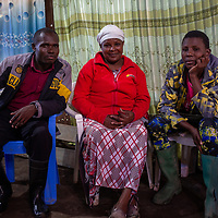 In a church in Mukuru Kwa Njenga, parishioners wait for the start of a meeting on sexual health and reproductive rights.