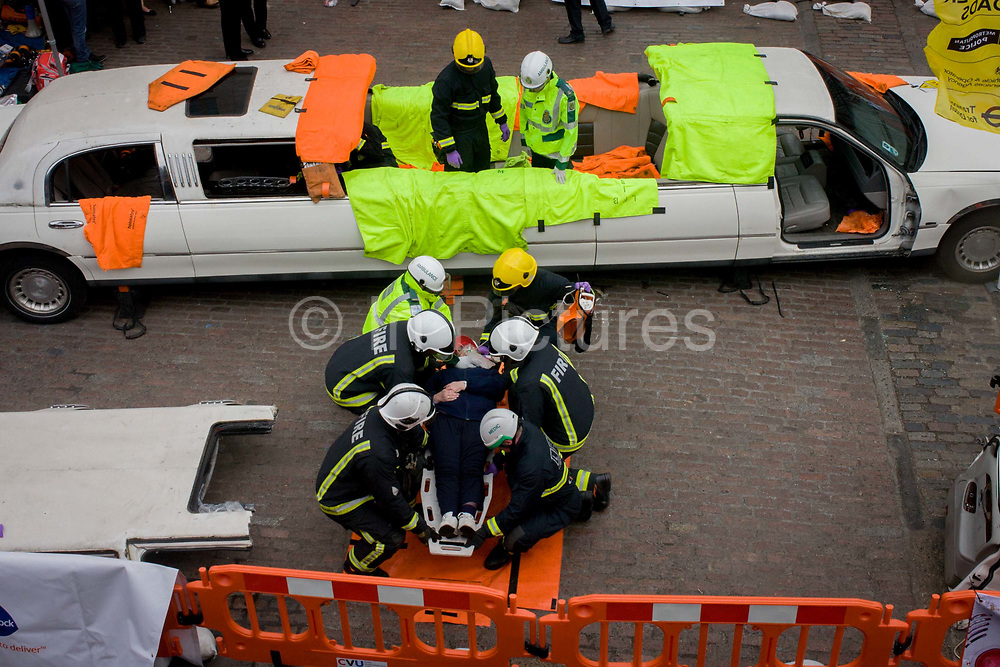 A volunteer casualty is rescued by medics and firefighters during a London Fire Brigade's 'extrication' team's demonstration with the Vehicle and Operator Services Agency (VOSA) on how firefighters rescue passengers by cutting open with dedicated cutting equipment a stretch limousine in London's Covent Garden Piazza. Highlighting the dangers of hiring illegal luxury or novelty cars, this vehicle was seized last year with many mechanical defects rendering it unsafe for those inside with limited exit doors. Of 358 cars stopped in March 2012, 27 were seized and 232 given prohibitions.