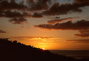 A sunset in Antigua overlooking the ocean.
