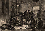A tub of dead and wounded brought to the surface after the catastrophe at the Jabin coal pit, Treuil, Saint-Etienne, France. In the background anxious relatives are waiting for news of the casualties.  On 4 February 1876 and explosion of  fire-damp, the inflammable gas Methane, cost the lives of 210 miners.  From 'Le Voleur', Paris, 18 February 1876.  Engraving.
