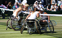 Diede De Groot (top left) and Yui Kamiji (bottom left) after winning the Ladies' Wheelchair Doubles Final against Sabine Ellerbrock (top right) and Lucy Shuker (bottom right) on day thirteen of the Wimbledon Championships at the All England Lawn Tennis and Croquet Club, Wimbledon. PRESS ASSOCIATION Photo. Picture date: Sunday July 15, 2018. See PA story TENNIS Wimbledon. Photo credit should read: Steven Paston/PA Wire. RESTRICTIONS: Editorial use only. No commercial use without prior written consent of the AELTC. Still image use only - no moving images to emulate broadcast. No superimposing or removal of sponsor/ad logos. Call +44 (0)1158 447447 for further information.