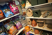Bird seed, nuts and boxes on sale in the shop at the RSPB's bird and wildlife reserve at Rainham Marshes, Essex.