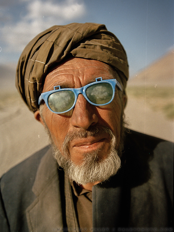 Juma Amu, one of the passenger of our convoy waits patiently while our car is stuck yet again.<br /> <br /> Adventure through the Afghan Pamir mountains, among the Afghan Kyrgyz and into Pakistan's Karakoram mountains. July/August 2005. Afghanistan / Pakistan.