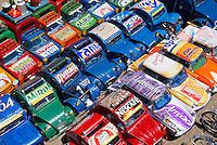 Madagascar. Voitures miniatures fabriquees avec des boites de conserves et vendue sur la route National 7. // Madagascar. Toy car made with metal food box and sold on the National 7 road.