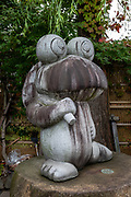 Frog statue on Nawate Dori shopping street, Matsumoto, Nagano Prefecture, Japan. Matsumoto has an annual two-day Frog Festival.