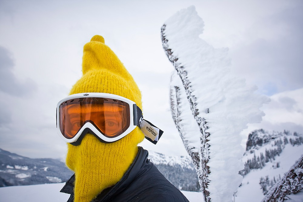 Snowboarder Aldo Compagnoni wears ski goggles and a yellow balaklava in the Mount Baker backcountry along the classic ski tour around Table Mountain, Mount Baker-Snoqualmie National Forest, Washington.
